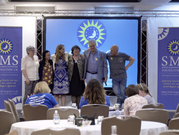 Board of Trustees and Ann Smith on stage at the 2017 SMS conference