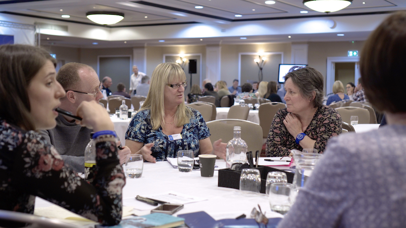 Group of people discussing issues at 2017 SMS conference