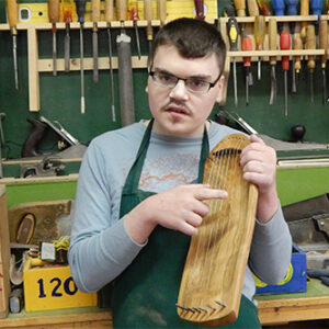 Young SMS man with wood working
