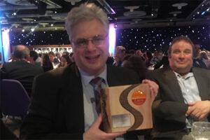 Trustee Nigel Over holding SCVO Award